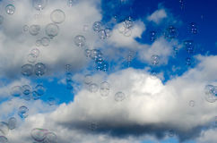 Clouds, blue sky and bubbles Stock Photo