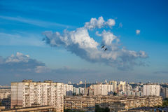 Clouds on blue sky in cityscape. Stock Image