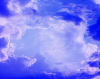 Clouds in the blue sky closeup. Natural blue background Royalty Free Stock Photo