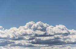 Clouds and blue sky. Cloudscape against a blue sky. Suitable for background or sky replacement Royalty Free Stock Image