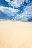Clouds blue sky desert sand dune background Stock Images