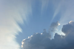 Clouds in the blue sky. With dramatic sunlight Royalty Free Stock Photo
