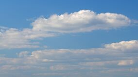 Clouds in the blue sky. Fast moving. Timelapse.