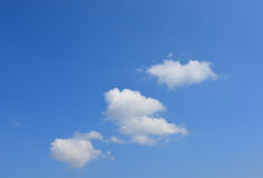 Clouds on the blue sky. Heart shape. Blue Sky surface with beautiful clouds. Love is in the air Stock Photography