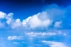 Clouds with blue sky high above the ground Stock Image