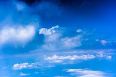 Clouds with blue sky high above the ground Stock Photos