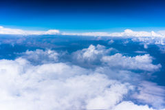 Clouds with blue sky high above the ground Stock Photography