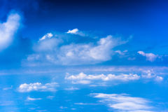 Clouds with blue sky high above the ground Stock Photo