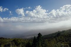 Clouds on blue sky in mountains. Tenerife, Teide Royalty Free Stock Image