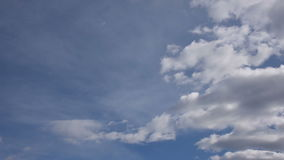 Clouds in the blue sky. Clouds moving fast in the blue sky stock footage