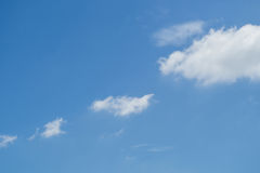 Clouds in the blue sky at noon. Stock Images