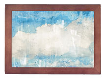 Clouds, blue sky in old wooden frame on white Stock Photo