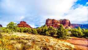 Clouds and blue sky over Bell Rock and Courthouse Butte between the Village of Oak Creek and Sedona in northern Arizona. Clouds and blue sky over Bell Rock and stock image