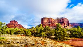 Clouds and blue sky over Bell Rock and Courthouse Butte between the Village of Oak Creek and Sedona in northern Arizona royalty free stock photography