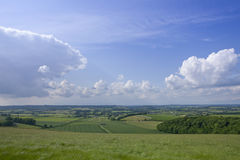 Clouds in blue sky over countryside Royalty Free Stock Photos