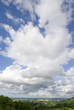 Clouds in blue sky over countryside Royalty Free Stock Photography