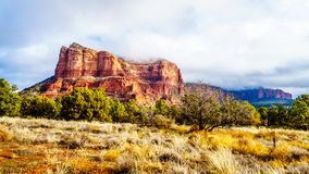 Clouds and blue sky over Courthouse Butte between the Village of Oak Creek and the town of Sedona in northern Arizona stock image