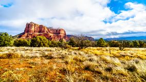 Clouds and blue sky over Courthouse Butte between the Village of Oak Creek and the town of Sedona in northern Arizona. In Coconino National Forest, United stock photography