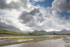 Clouds with blue sky over irish hills and estuary Royalty Free Stock Photography
