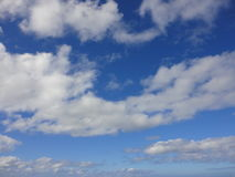 Clouds in blue sky over ocean of Hawaii Stock Images