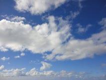Clouds in blue sky over ocean of Hawaii Stock Photos