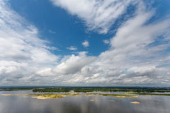Clouds and blue sky over the river Royalty Free Stock Images