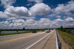 Clouds and blue sky over the road Stock Photography