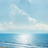 Clouds in blue sky over sea and reflections Royalty Free Stock Photo
