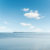 Clouds in blue sky over sea Royalty Free Stock Image