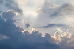 Clouds on blue sky pierced by ray of sunlight, horizontal Royalty Free Stock Photos