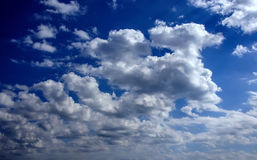 Clouds on blue sky. The rays of the sun from behind the clouds stock images