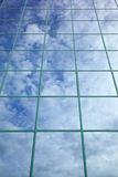 Clouds and blue sky reflected in glass facade Royalty Free Stock Photos