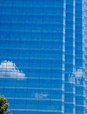 Clouds and Blue Sky Reflected in Wall of Glass Stock Photos