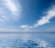 Clouds on blue sky with rendered water Stock Image
