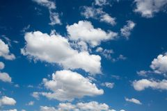 Clouds in the blue sky. Scatered clouds in the blue sky stock images