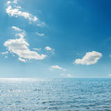 Clouds in blue sky and sea Stock Photo
