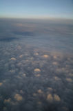 Clouds and blue sky seen from plane Royalty Free Stock Image