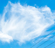 Clouds in the blue sky and small electric line Royalty Free Stock Photo