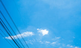 Clouds in the blue sky and small electric line Stock Photo