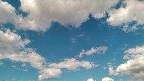 Clouds on the blue sky. In summer royalty free stock photos