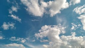 Clouds on the blue sky. In summer stock photos