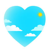 Clouds on blue sky with sun heart shape Royalty Free Stock Image