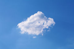 Clouds on blue sky with sun rays behind Stock Photos