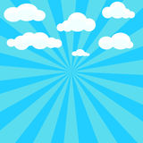 Clouds and blue sky with sunburst on background Stock Photos