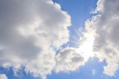 Clouds and blue sky with sunlight sunbeams or sunrays. royalty free stock images