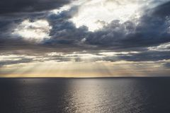 Clouds blue sky and sunlight sunset on horizon ocean . Ð¡loudscape on background seascape dramatic atmosphere rays sunrise. Relax. View waves sea with ship stock image