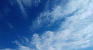 Clouds and blue sky, on a very bright winter. Day Royalty Free Stock Photo
