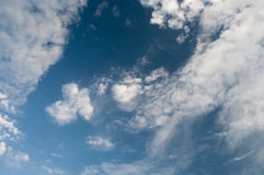 Clouds on blue sky. White fluffy clouds in the blue sky Royalty Free Stock Photo