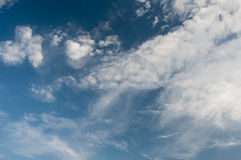 Clouds on blue sky. White fluffy clouds in the blue sky Royalty Free Stock Photography