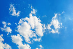 Clouds in blue sky. Blue sky with white fluffy cumuli clouds Royalty Free Stock Images